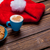 photo of delicious fresh croissant santa claus hat and cup of c stock photo © massonforstock
