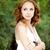 mosolyog · vonzó · lány · piros · pöttyös · ruha · park - stock fotó © massonforstock