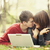 Beautiful couple with laptop at autumn park. stock photo © Massonforstock