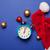clock and Santa Claus hat stock photo © Massonforstock