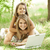 Two sisters with laptop in the park. stock photo © Massonforstock