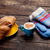 photo of delicious fresh croissant cup of coffee and warm glove stock photo © massonforstock