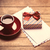 photo of cup of coffee envelopes and cute wrapped gift on the w stock photo © massonforstock