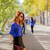 beautiful young woman walking in the park stock photo © massonforstock