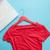 photo of shirt on hanger and laptop on the wonderful blue backgr stock photo © massonforstock