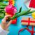 white caucasian female hand holding yellow tulip near things for stock photo © massonforstock