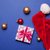 Gift and Santa Claus hat with baubles  stock photo © Massonforstock