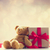 cute teddy bear red ribbon and beautiful gifts on the fairy lig stock photo © massonforstock