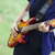 Close-up view at guitar in girl's hands at outdoor. stock photo © Massonforstock