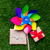 pinwheel toy and two gift boxes on green grass background above stock photo © massonforstock