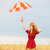redhead girl with umbrella at wheat field stock photo © massonforstock
