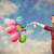 beautiful young woman with colorful balloons on the wonderful sk stock photo © massonforstock