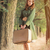 photo of beautiful young woman with suitcase on the wonderful tr stock photo © massonforstock