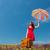 vörös · hajú · nő · esernyő · bőrönd · tavasz · felhők · nők - stock fotó © massonforstock
