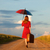 Redhead girl with umbrella and suitcase at outdoor stock photo © Massonforstock