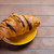 photo of delicious fresh croissant on the wonderful brown wooden stock photo © massonforstock