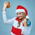 girl dressed in santa hat holding a christmas decoration stock photo © master1305