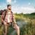 jonge · man · rugzak · knap · permanente · Maakt · een · reservekopie · kompas - stockfoto © master1305