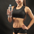 muscular young woman athlete with a water on black stock photo © master1305
