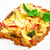 crispy veal schnitzel with cheese tomatoes peppers broccoli and mushrooms stock photo © master1305