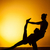 two people practicing yoga in the sunset light stock photo © master1305