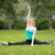 beautiful young woman doing stretching exercises in the park stock photo © master1305
