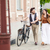 young couple walking with bicycle and hugging stock photo © master1305