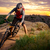 cyclist riding the bike on the mountain rocky trail at sunset stock photo © maxpro