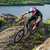 professional cyclist riding the bike on the beautiful spring mountain trail extreme sports stock photo © maxpro
