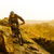 enduro cyclist riding the mountain bike down beautiful rocky trail extreme sport concept space for stock photo © maxpro