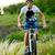 fietser · paardrijden · fiets · mooie · voorjaar · berg - stockfoto © maxpro