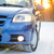 blue car with winter tires on snowy road at sunset with bright sun travel and safe driving concept stock photo © maxpro