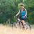 fiatal · kerékpáros · legelő · alkalmi · ruha · mesés · természet - stock fotó © maxpro