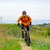cyclist riding the bike on the beautiful mountain trail stock photo © maxpro