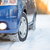 blue car with winter tires on the snowy road drive safe stock photo © maxpro