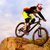 professional cyclist riding the bike on the top of the rock extreme sport concept space for text stock photo © maxpro