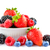 big pile of fresh berries in bowl on the white background stock photo © maxpro