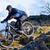 cyclist riding the bike on the rocky trail at sunset extreme sport concept space for text stock photo © maxpro
