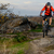 cyclist in red jacket riding the bike on rocky trail extreme sport stock photo © maxpro