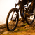 enduro cyclist riding the bike down rocky hill at sunset close up extreme sport concept space for stock photo © maxpro