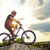 professional down hill cyclist resting with bike on the rock at sunset extreme sport stock photo © maxpro