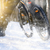 Professional Cyclist Riding the Bike on the Snowy Trail Lit by Sun. Winter Extreme Sports Concept. stock photo © maxpro