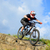 professional cyclist riding the bike down rocky hill extreme sport stock photo © maxpro