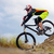 professional cyclist riding the bike down rocky hill extreme sport concept space for text stock photo © maxpro