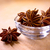 Star Anise in the Glass Bowl on Wooden Table stock photo © maxpro