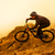 enduro cyclist riding the mountain bike on the rock extreme sport concept space for text stock photo © maxpro