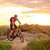 Cyclist Riding the Bike on Mountain Rocky Trail at Sunset stock photo © maxpro