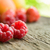 ripe sweet raspberries and fruits on the wooden table stock photo © maxpro