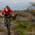 cyclist in red jacket riding the bike on the rocky trail extreme sport space for text stock photo © maxpro