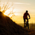 silhouette of enduro cyclist riding the mountain bike on the rocky trail at sunset active lifestyle stock photo © maxpro